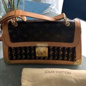 Louis Vuitton Boucle Daphne monogram clutch